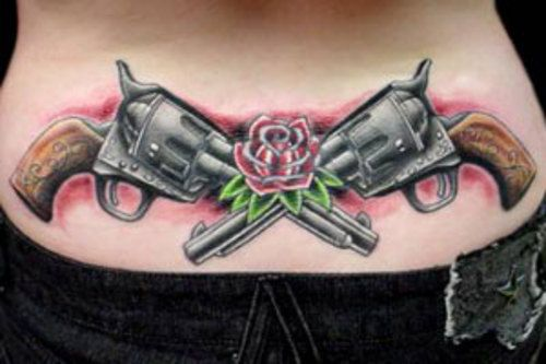 6c8322127 Crossed Pistols And Rose Flower Tattoo On Lower back