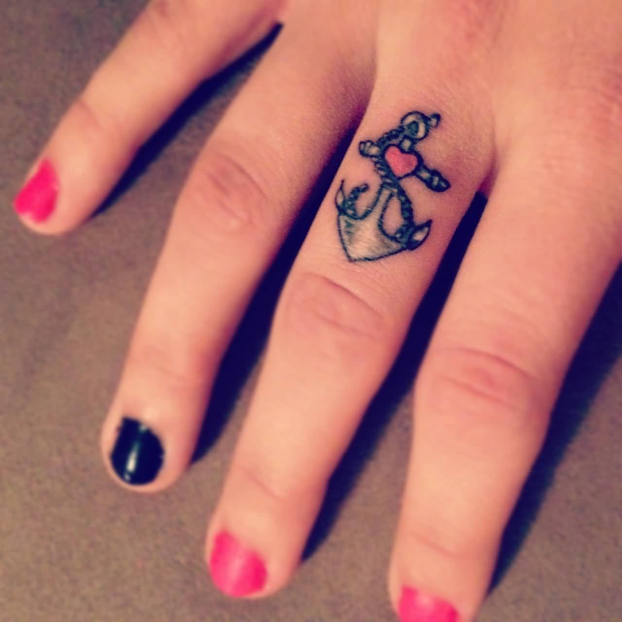 cute small anchor tattoo on girls middle finger. Black Bedroom Furniture Sets. Home Design Ideas