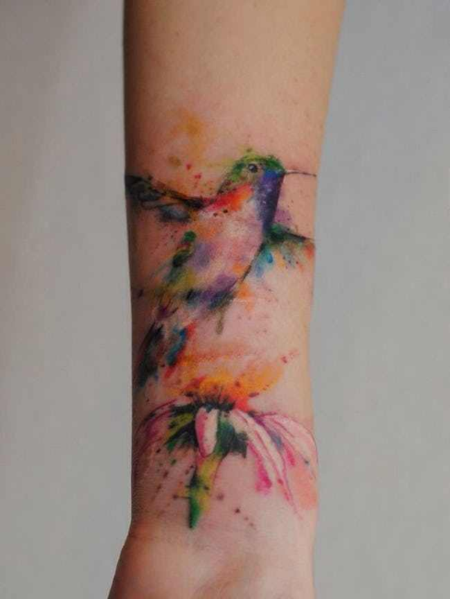 Flying Hummingbird Watercolor Tattoo On Wrist