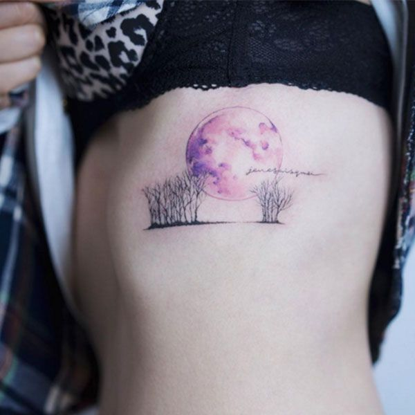 forest and full moon watercolor tattoo on side rib cage forest and full moon watercolor tattoo
