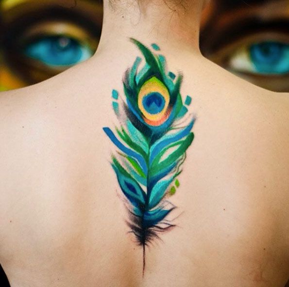 Peacock feather tattoo on back for Peacock back tattoo