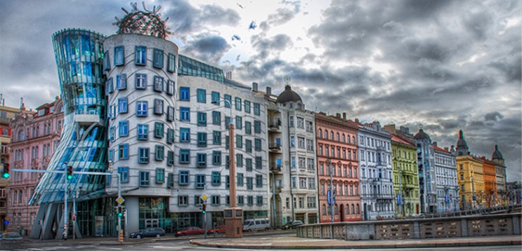Side View Of The Dancing House With Black Clouds