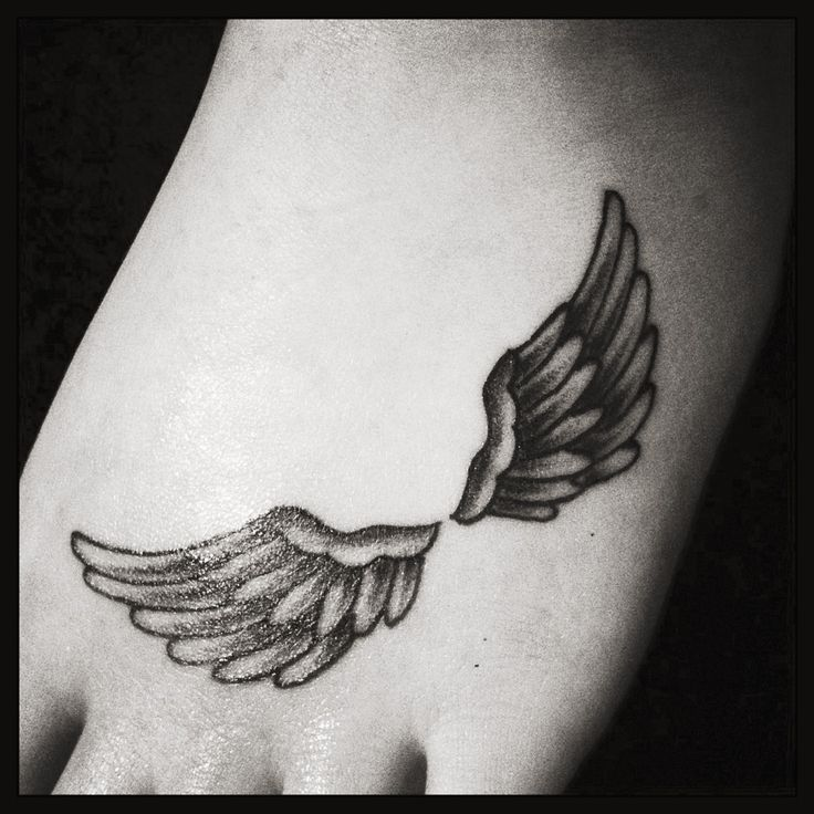 small angel wings tattoo on foot. Black Bedroom Furniture Sets. Home Design Ideas