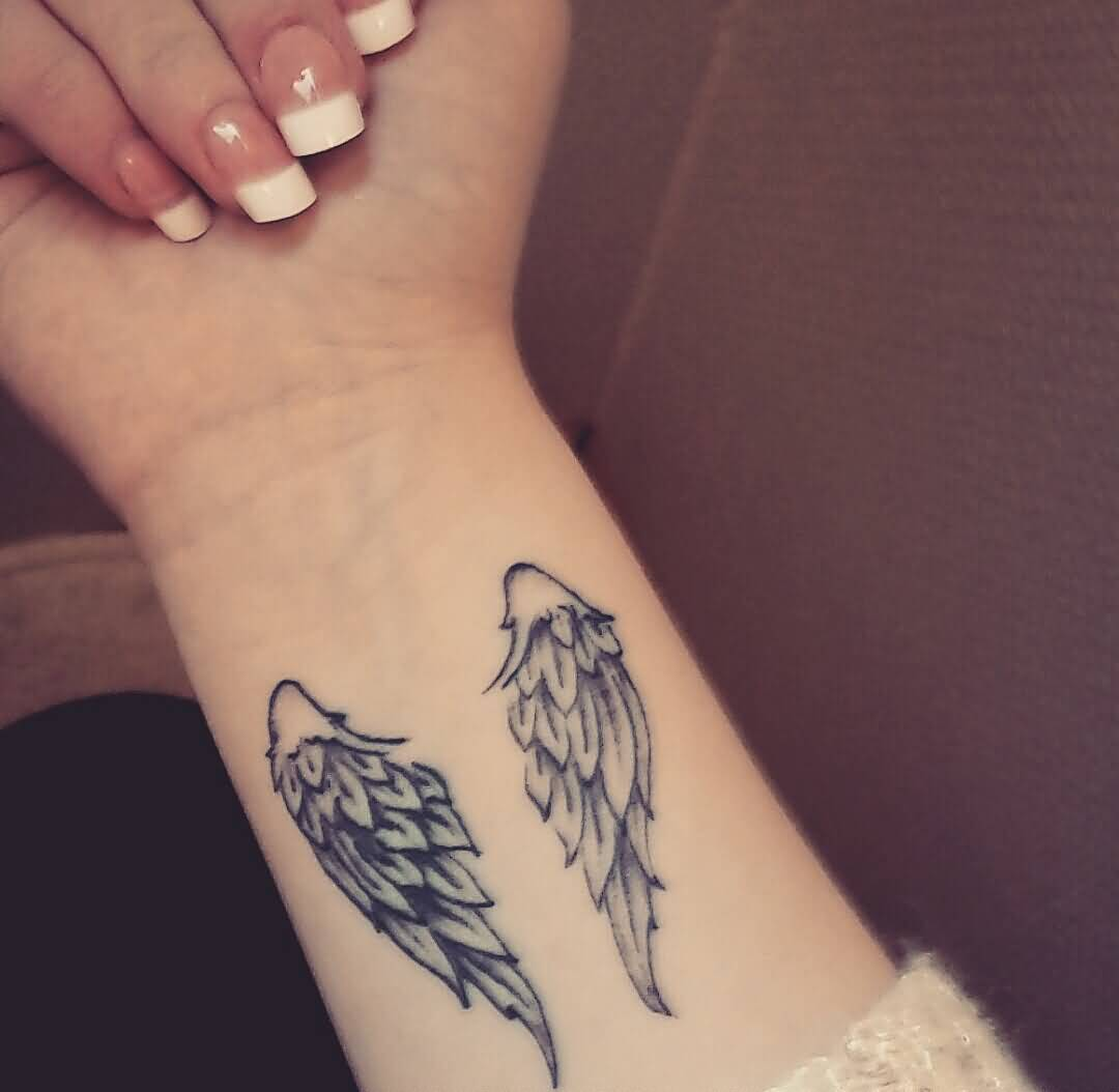 small wing tattoo on wrist. Black Bedroom Furniture Sets. Home Design Ideas