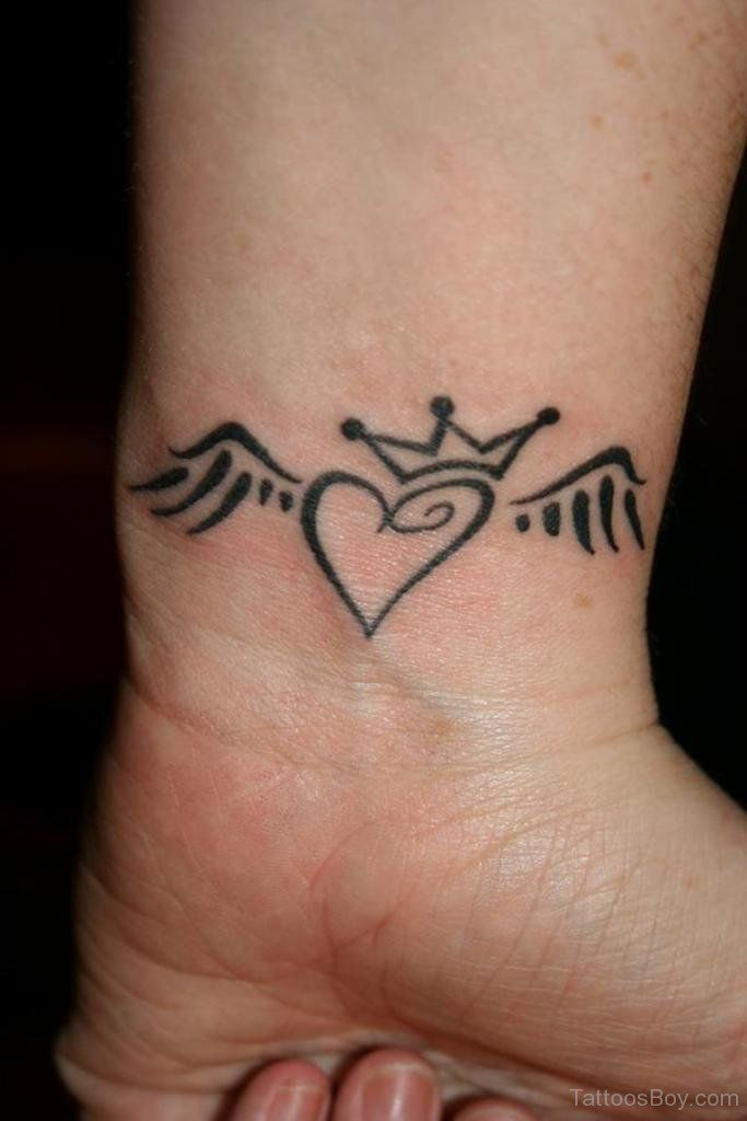 Winged Heart With Crown Tattoo On Wrist