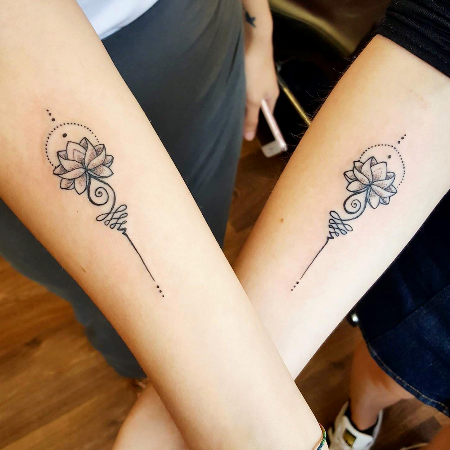 adorable lotus matching tattoo on wrists. Black Bedroom Furniture Sets. Home Design Ideas