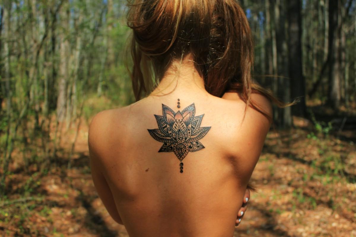 70 best lotus flower tattoo design ideas amazing tribal lotus tattoo on girls back izmirmasajfo