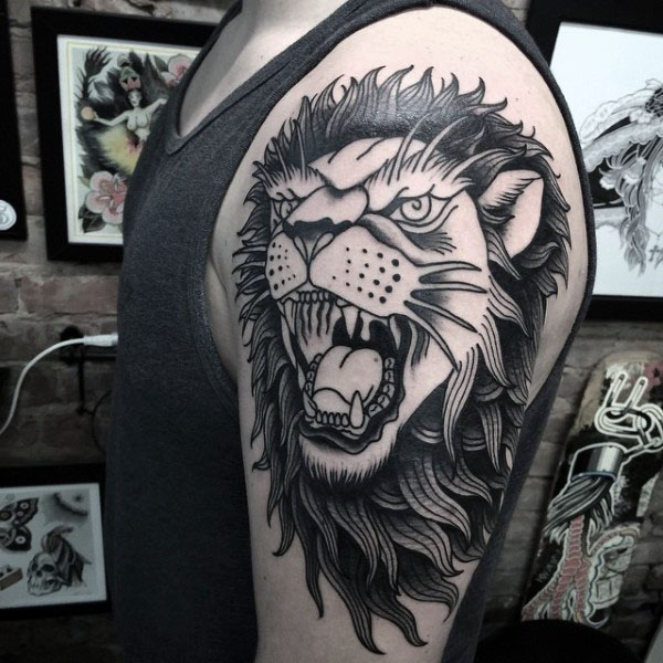 Black And Grey Ink Traditional Lion Tattoo For Men On Upper Arm