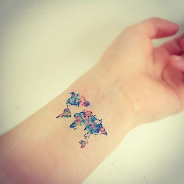 101 best travel tattoo designs and ideas colorful world map travel tattoo inspiration gumiabroncs Gallery