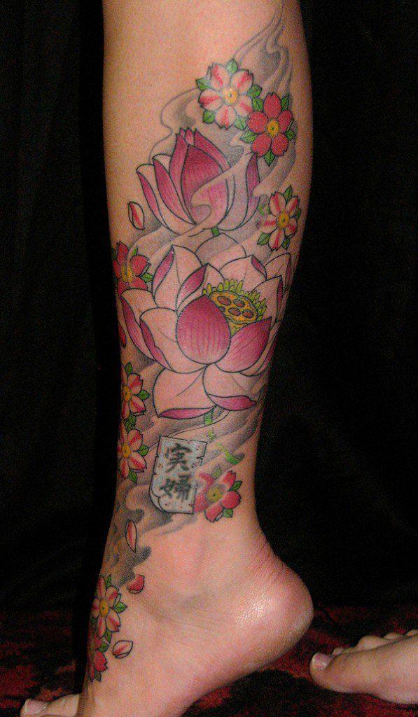 Elegant Lotus Flowers Tattoo On Leg