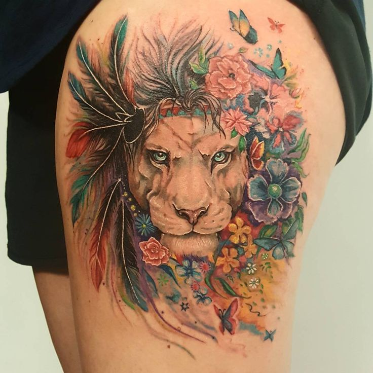 feminine lion with feathers colorful tattoo on thigh. Black Bedroom Furniture Sets. Home Design Ideas