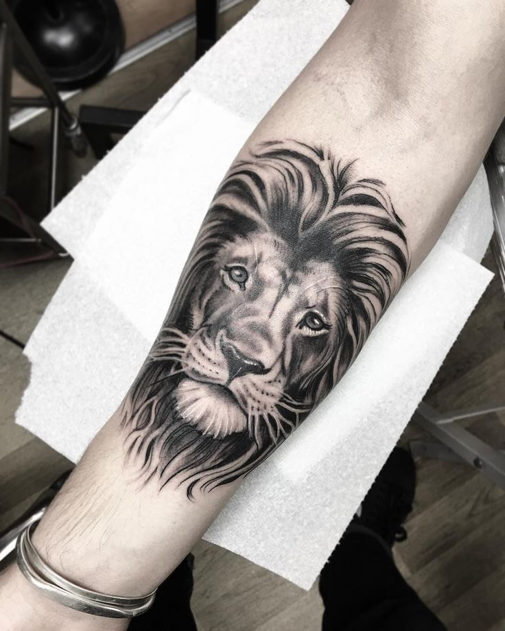 Lion Face Tattoo On Forearm