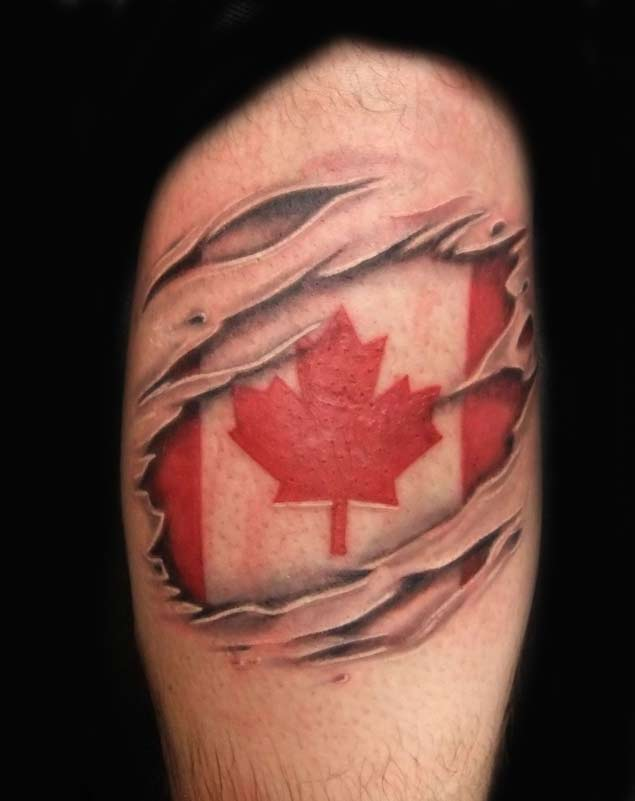 ripped skin canadian flag tattoo