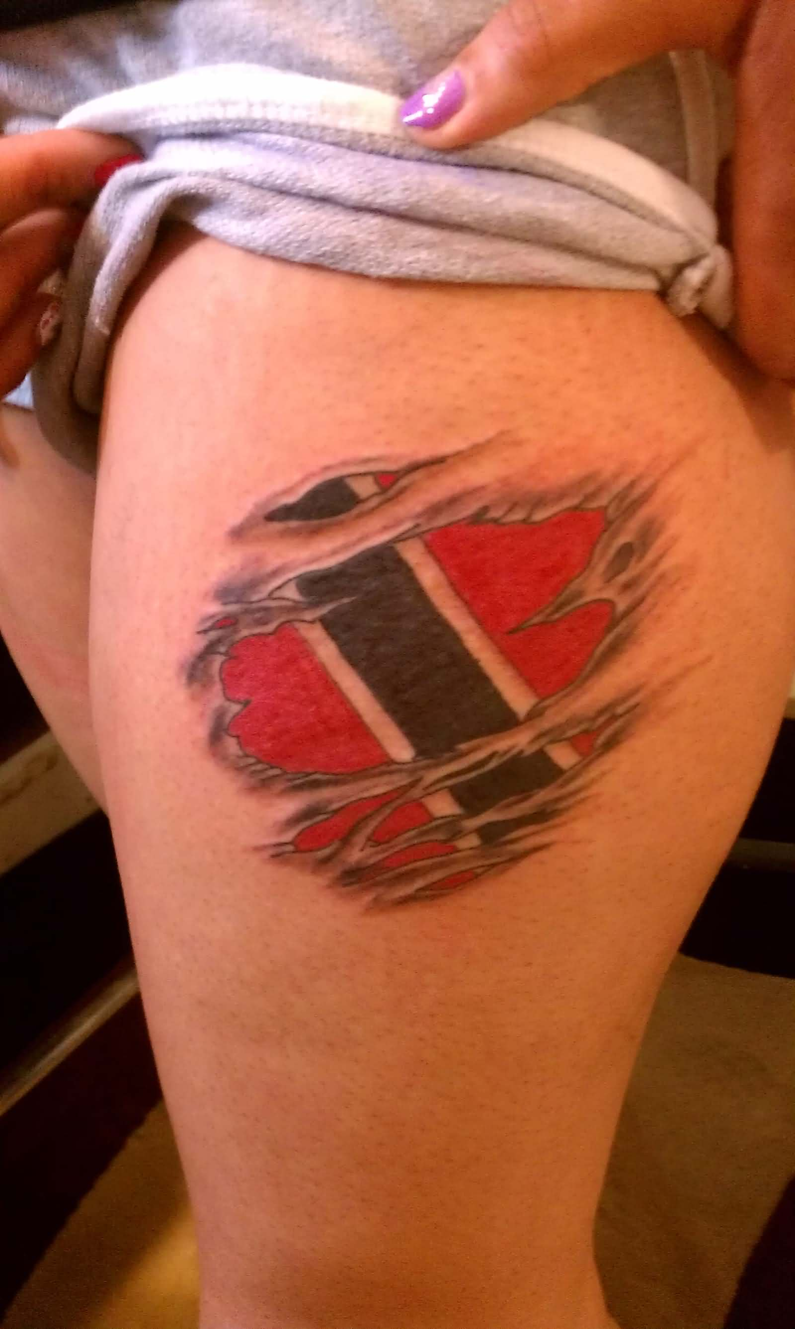 Name canadian flag ripping through skin tattoo designjpg pictures - Trinidad Flag Tattoo On Thigh