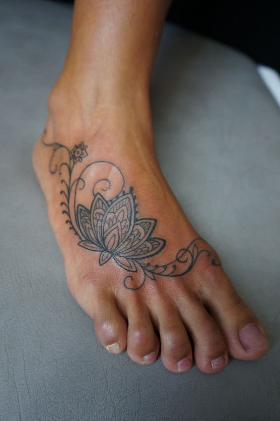 Tribal Lotus Tattoo On Foot