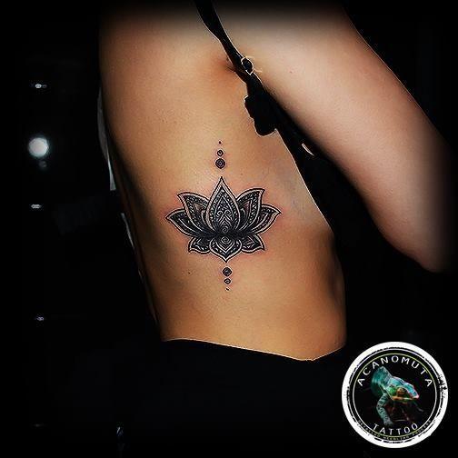 Stunning Black Lotus Tattoo On Side Rib