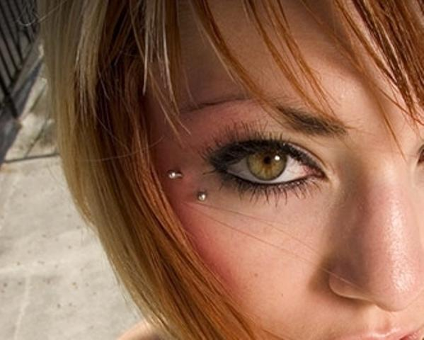 Anti Eyebrow Piercing Using Silver Curved Barbell Under Right Eye