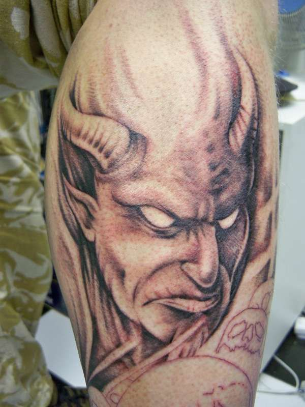 1074a0580 Grey Ink Scary Devil With Horns Tattoo On Bicep For Men