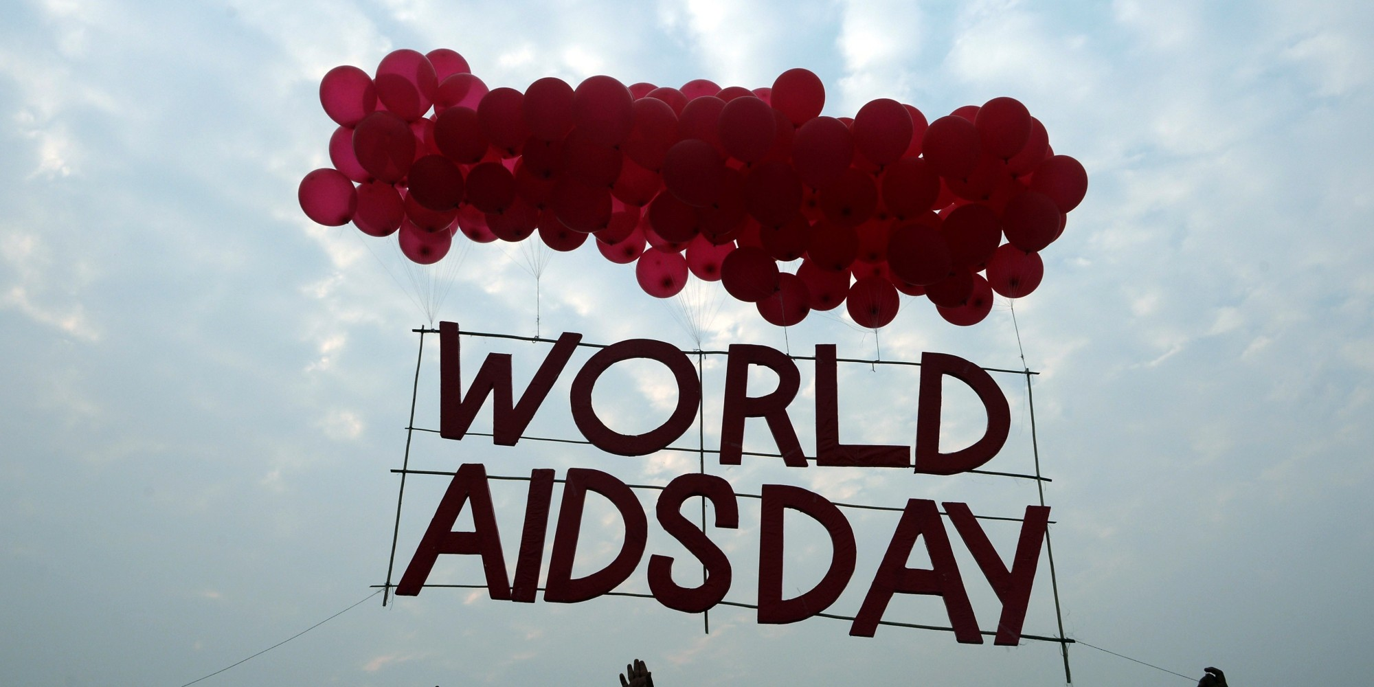 celebrating World Aids Day logo flying with balloons picture