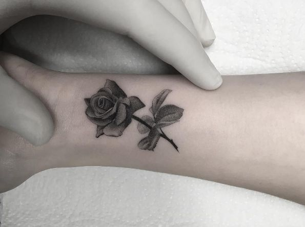 Small Grey Tattoo: Dark Grey Small Rose Tattoo On Wrist