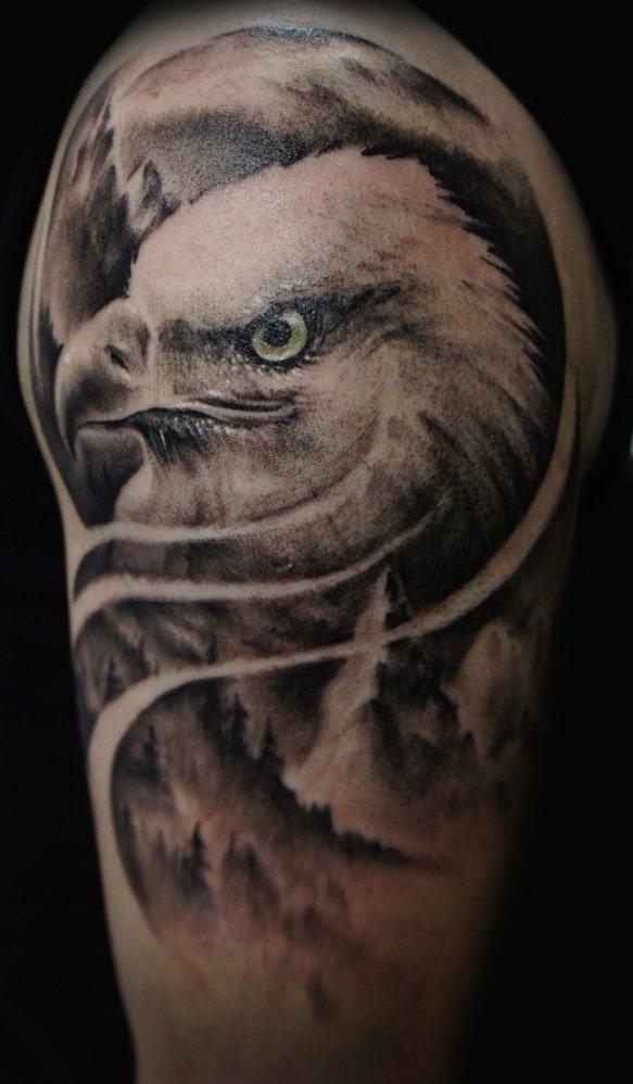 awesome grey ink bald eagle head in clouds tattoo design on shoulder. Black Bedroom Furniture Sets. Home Design Ideas