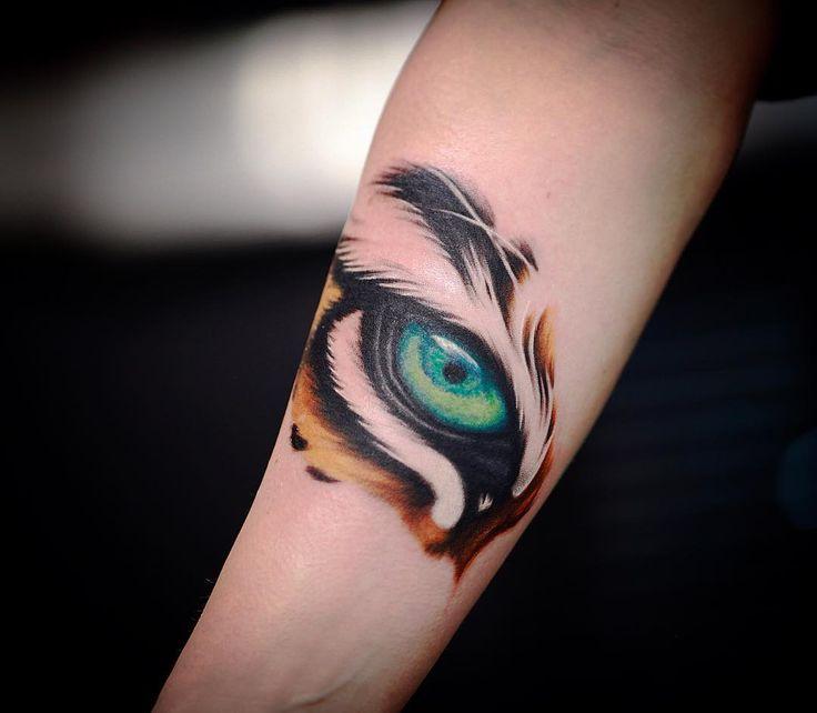 Blue Tigr Eye Tattoo On Forarm For Girls