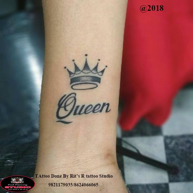 Small Crown With Word Queen Tattoo On Forearm