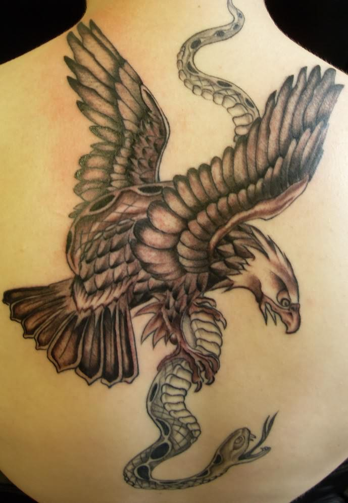 Grey Ink Eagle And Snake Tattoo On Girl Back