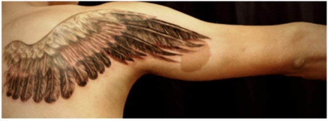 Grey ink eagle wing tattoo on back shoulder for Eagle wings tattoo