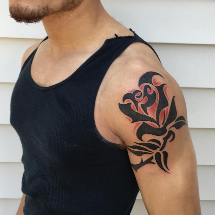 Black Tribal Rose With Red Shaded Tattoo Design On Male Shoulder
