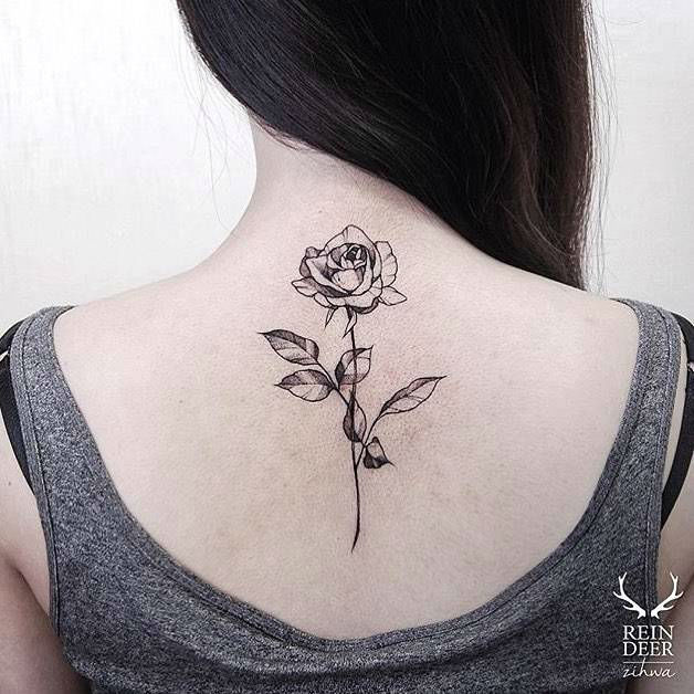 stunning black rose tattoo on girl back by reindeer