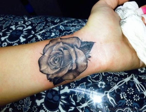 Wonderful Realistic Black Rose Tattoo On Wrist
