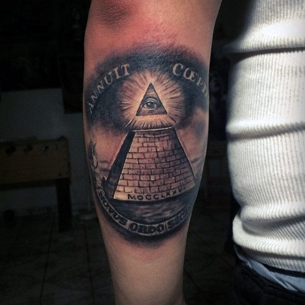3e4abc5e06808 Black Ink Bright Glowing Illuminati On Pyramid Top Tattoo On Male Arm