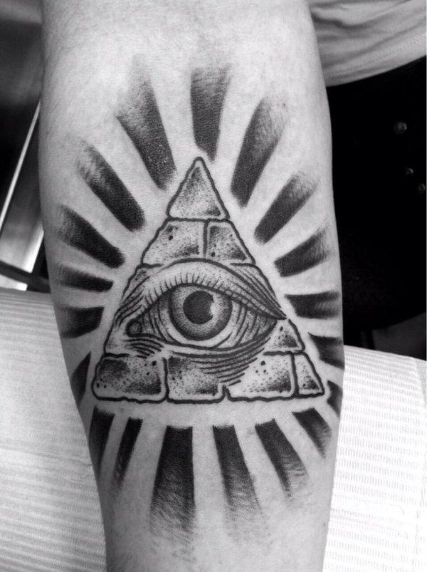 Black Ink Glowing Illuminati Tattoo On Forearm