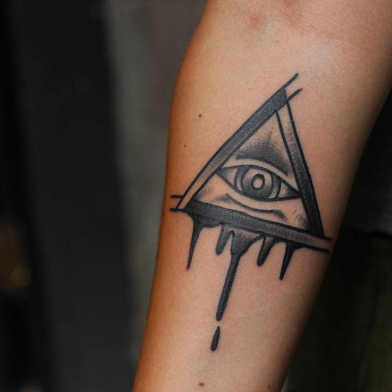 Black Shaded Melting Illuminati Tattoo On Forearm For Girls