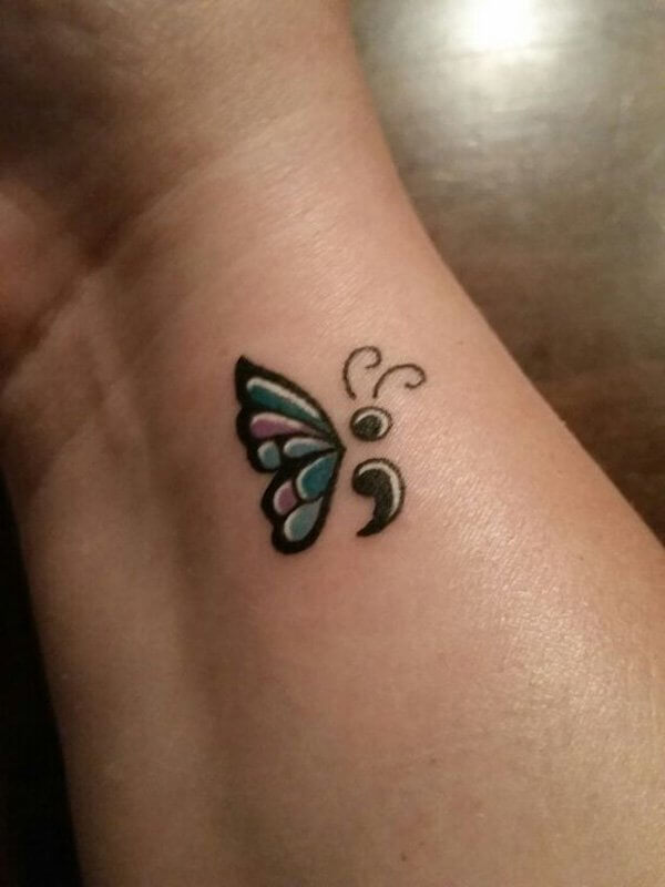 colorful butterfly and semicolon tattoo on wrist. Black Bedroom Furniture Sets. Home Design Ideas