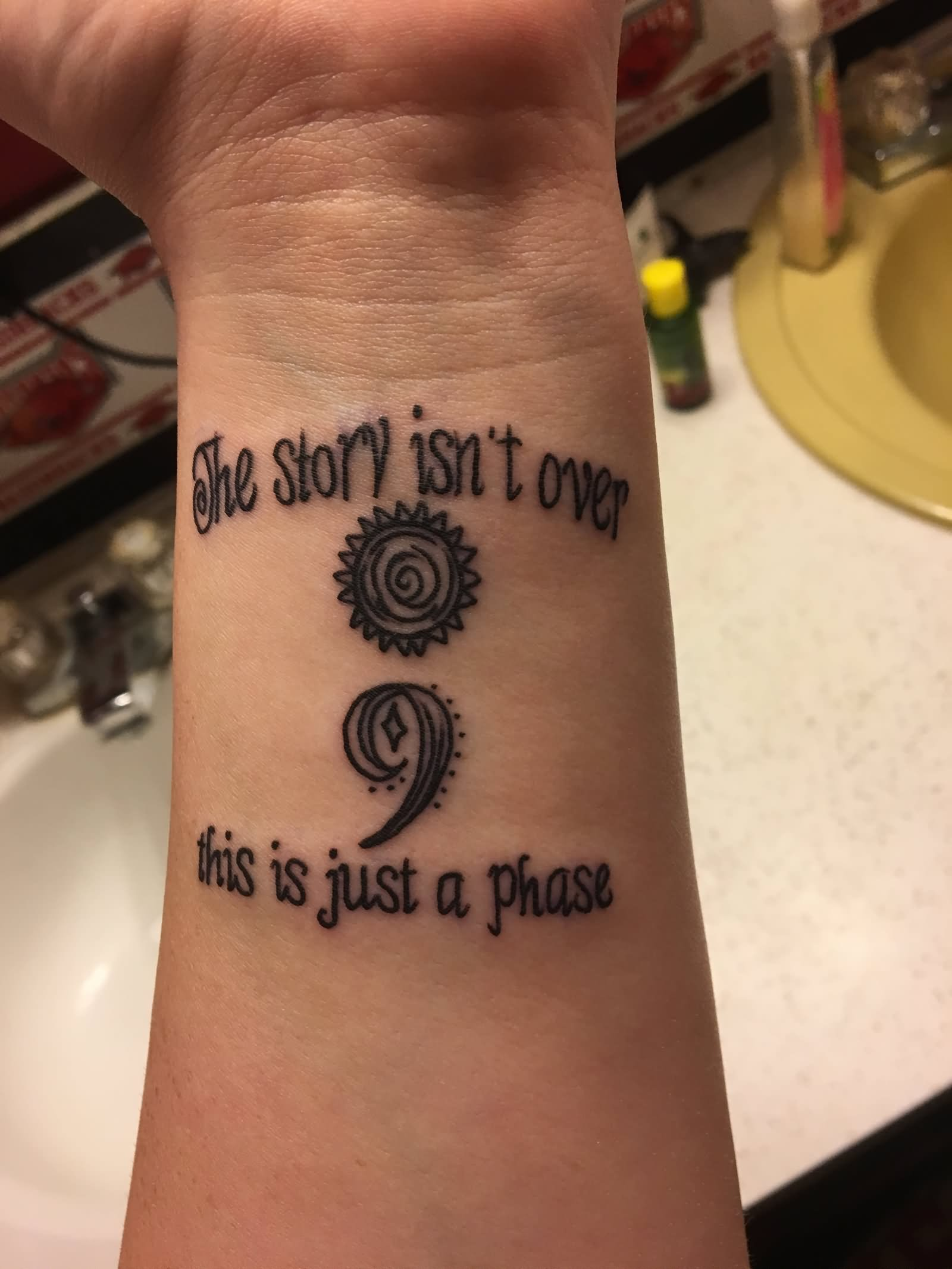 Inspirational Semicolon Tattoo On Wrist With Wording The Story Isn