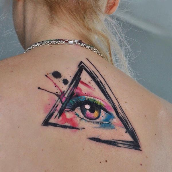 Watercolor Illuminati Tattoo Idea On The Girl Back
