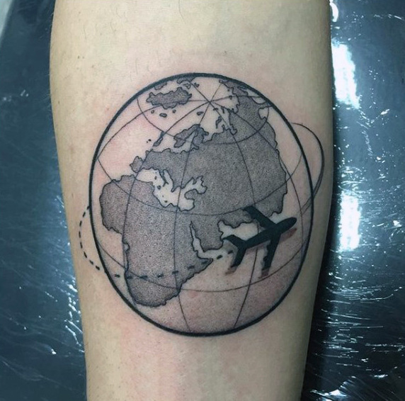 4d6d20fd2 Black shaded 3d globe and airplane tattoo on inner forearm