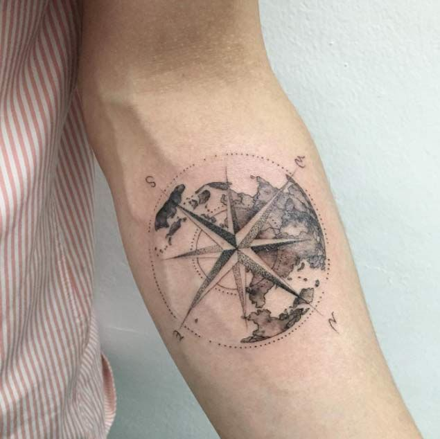 549dd0914 Black shaded globe and compass tattoo on inner arm for men
