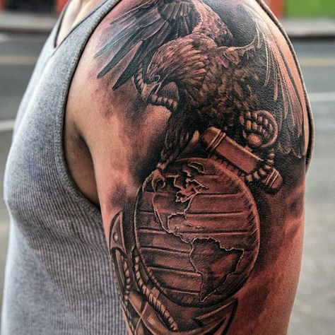 4ac46bbf69fc6 Black shaded globe, eagle and anchor tattoo on left upper arm for men