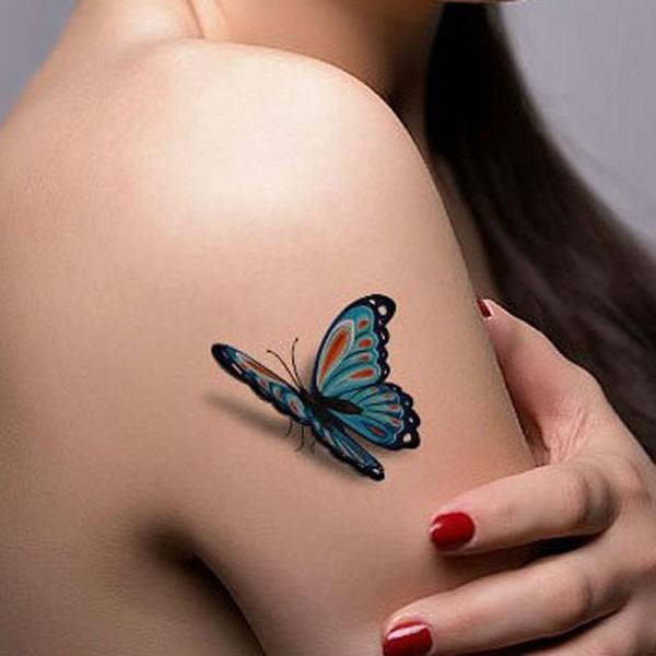 b1aa7c03b Colorful 3D butterfly tattoo on upper arm