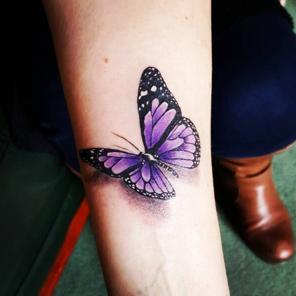 6e2034be59560 Purple butterfly tattoo on inner arm
