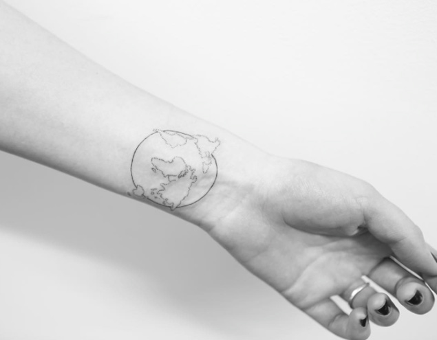 Small globe with map tattoo on inner wrist