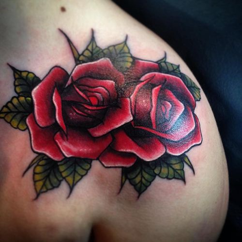 Traditional Two Lovely Red Roses Tattoo On Top Shoulder