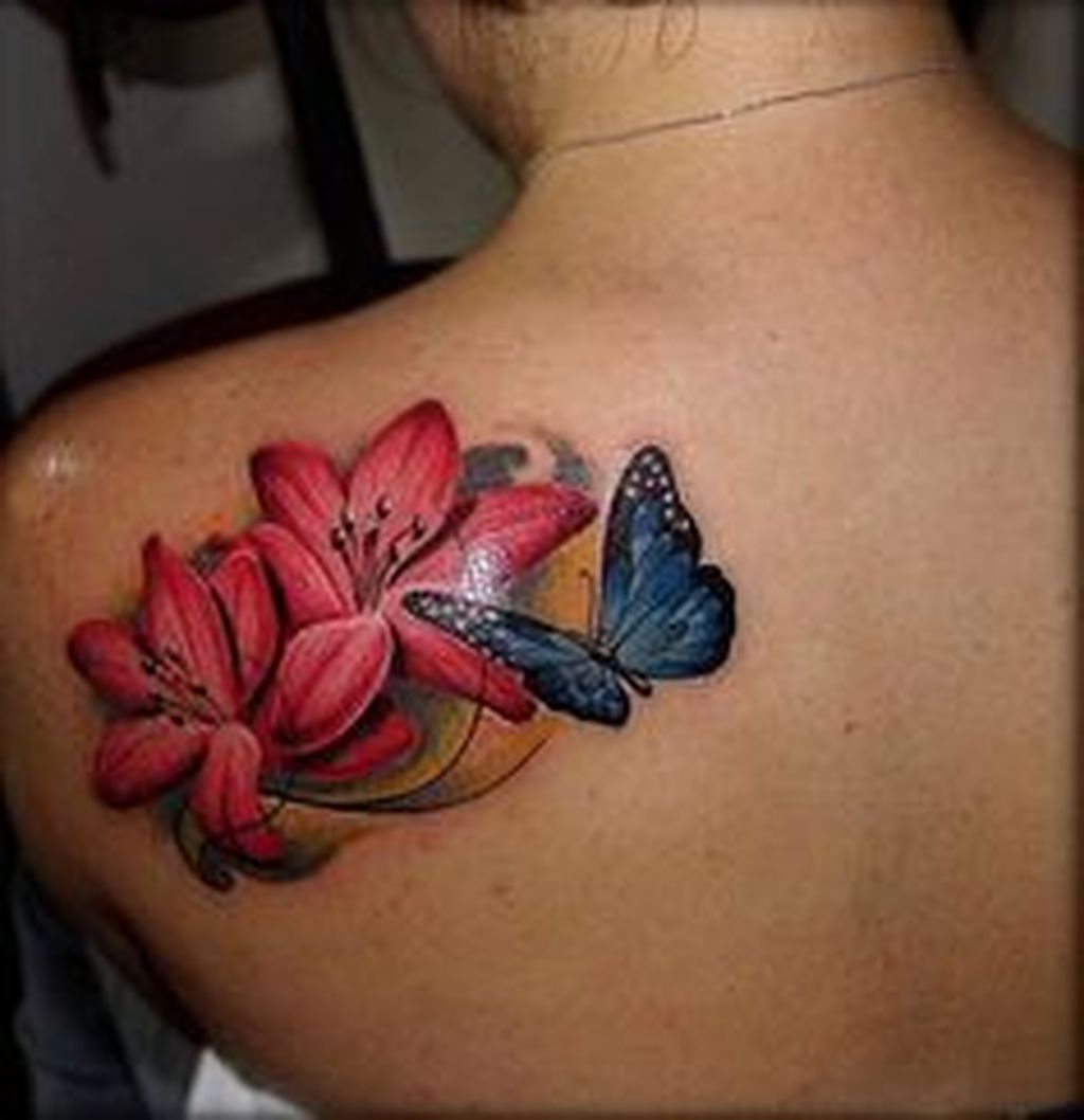Colorful Butterfly Tattoo With Flowers On Girls Left Upper Back