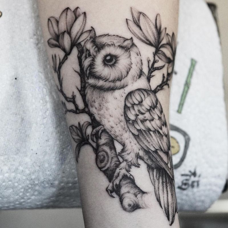 Black White Realistic Owl With Flowers And Branches Tattoo On