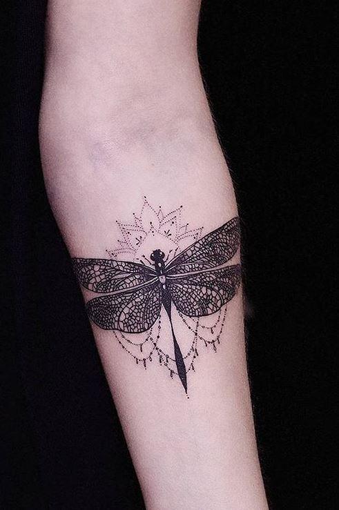 62462c40c9e9e Black Celtic dragonfly tattoo design on inner lower arm