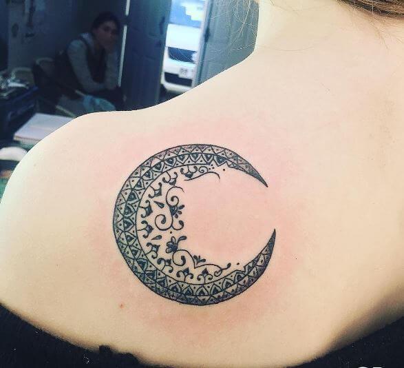 afa52ad3c Black half moon tattoo design on upper left back for women