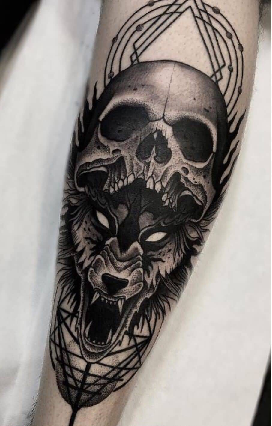 Black And Grey Skull And Wolf Tattoo On Arm For Men